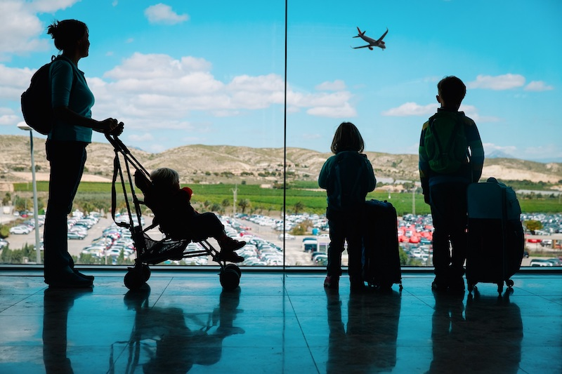 family traveling at airport